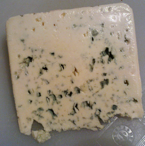 A really crappy picture of a wedge of bleu d'Auvergne