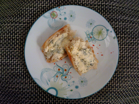 Bleu d'Auvergne slathered on pieces of fresh baguette