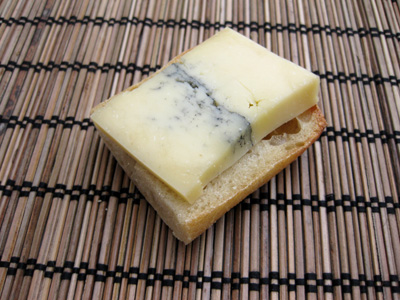 A tasty slice of Morbier on a chunk of bread
