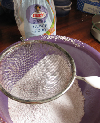 Sifting the powdered sugar and cocoa powder