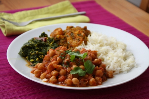 Chickpeas in spicy tomato gravy, spinach simmered in yogurt, kolmino patio, rice
